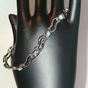 Silver colored bracelet with blue stones